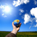 Globe in hand Royalty Free Stock Image