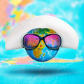 Globe with hat and pink sunglasses closeup of Stock Images