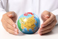 Globe  in human hand Royalty Free Stock Photos