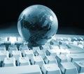 Globe and keyboard Royalty Free Stock Photo
