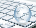 Globe on a keyboard laptop Royalty Free Stock Photo
