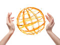 Globe from orange water with human hand isolated on white background Stock Images