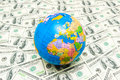 Globe over american dollar bank notes Royalty Free Stock Photo