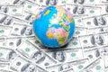 Globe over many american dollar notes Stock Photo
