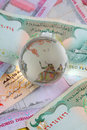 Title: Globe on uae currency dirham notes
