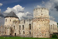 Gloomy castle old medieval under dark cloudy sky with birds fly around tower Royalty Free Stock Photos