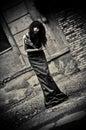 Gloomy portrait of strange depressive goth girl among the ruins low key a Stock Photos