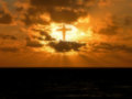 Glory to god a view of a sunset with the cross of showing in his creation Stock Photography