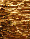 Glossy gold veins on the matte gold texture background Royalty Free Stock Photography