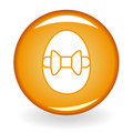 Glossy orange button with egg Royalty Free Stock Photos