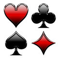 Glossy poker cards playing card clubs hearts diamonds and spades in their real colors with a effect Stock Photos