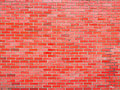 Glossy red brick wall a shine coated Stock Photo