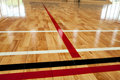 Glossy varnished sprung wooden floor for sports, basketball, gymnastics, gymnasium with court lines marked. Royalty Free Stock Photo