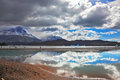 The glow mysterious bright reflections of sky and clouds in smooth cold water of lake grey chilean patagonia national park Royalty Free Stock Photography