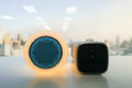 Glow speaker in orange color and modern wireless speaker for listening to music