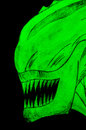 Glowing alien head in the dark drawn on a laser tag game room wall Stock Photos