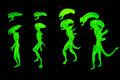 Glowing aliens in the dark in a laser tag arena Stock Image