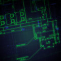 Glowing architectural drawings on dark background a business concept Royalty Free Stock Images