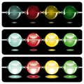 Glowing beads in the dark on three rows Stock Photography