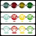 Glowing beads on white on three rows Royalty Free Stock Photography