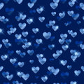 Glowing blue hearts sequins background.