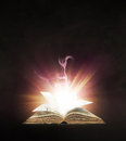 Glowing book with bright colorful lights Stock Photo