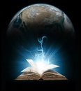 Glowing book with earth planet in background elements provided by nasa Royalty Free Stock Photos