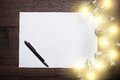 Glowing bulbs and blank sheet of paper Royalty Free Stock Photo