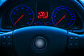 Glowing car dials dashboard of modern unmarked vehicle showing blue luminous and speedometer Royalty Free Stock Image