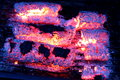 Glowing embers from wooden briquettes background texture Royalty Free Stock Photos