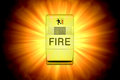 Glowing fire alarm silhouetted over a bright sunburst or fireball Stock Images