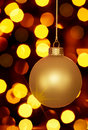 Glowing Gold Christmas Ornament And Holiday Lights Royalty Free Stock Photo