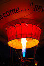 Glowing hot air ballon this shot was taken in albuquerque nm during the fiesta Stock Photos