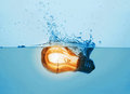 Glowing light bulb in water Royalty Free Stock Photo