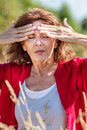 Glowing middle aged woman with freckles suffering from headache Royalty Free Stock Photo