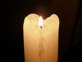 Glowing mourning candle in darkness. Royalty Free Stock Photo