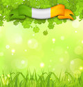 Glowing nature background with shamrocks, grass and Irish flag f Royalty Free Stock Photo