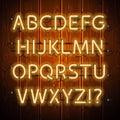 Glowing Neon Alphabet on Wooden Background