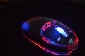 Glowing neon computer mouse