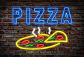 Glowing neon pizza sign on a brick wall Stock Photos