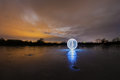 Glowing orb on the mirror surface of a frozen lake