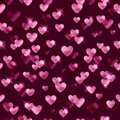 Glowing pink hearts sequins background.