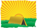Glowing sun rise over camping tent inside grassy f Stock Images