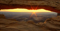 Glowing sunrise at Mesa Arch. Royalty Free Stock Photo