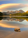 Glowing sunrise mountain reflection Royalty Free Stock Photo