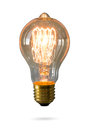 Glowing yellow light bulb isolated Royalty Free Stock Photo