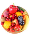 Glucometer with fruits and vegetables on wooden plate Royalty Free Stock Photo