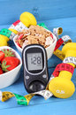 Glucometer with sugar level, healthy food, dumbbells and centimeter, diabetes, healthy and sporty lifestyle Royalty Free Stock Photo