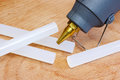 Glue gun closeup with glue plastic rods Royalty Free Stock Photo