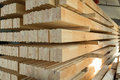 Glued timber beams pine in a production manufactory Stock Photos